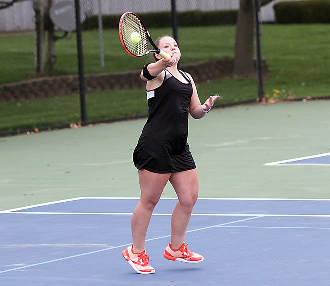 Mackenzie McMillin of Sturgis hits a return shot in her match at third singles on Wednesday afternoon.