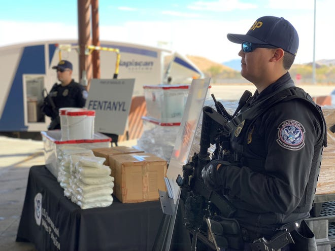 U.S. Customs and Border Protection agents guard  several kilos of fentanyl seized at the Nogales-Mariposa Port of Entry in Arizona.