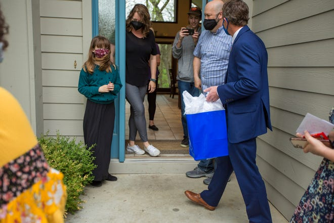 """""""It's my school,"""" said Erin Davidson, a fourth-grader at Jay Shideler Elementary, as administrators at Auburn-Washburn USD 437 surprised her by recognizing her at her home Wednesday for positively contributing to the school's community."""