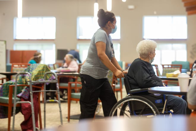 Staff at Midland Care's Program of All Inclusive Care for The Elderly, 2134 S.W. Westport Drive, help those receiving care get around the facility on Thursday.