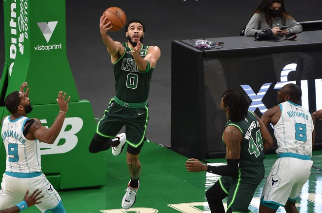 Celtics forward Jayson Tatum lays the ball in the basket during the first half against the Hornets at TD Garden.