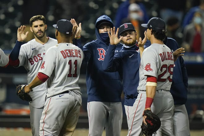 The Red Sox celebrate a two-game series sweep of the New York Mets on Wednesday night.