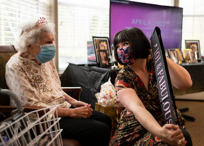 Program director Chrissy Blunt dresses Lillian Kane with a crown and sash for her 101st birthday celebration at Tatnuck Park Wednesday.