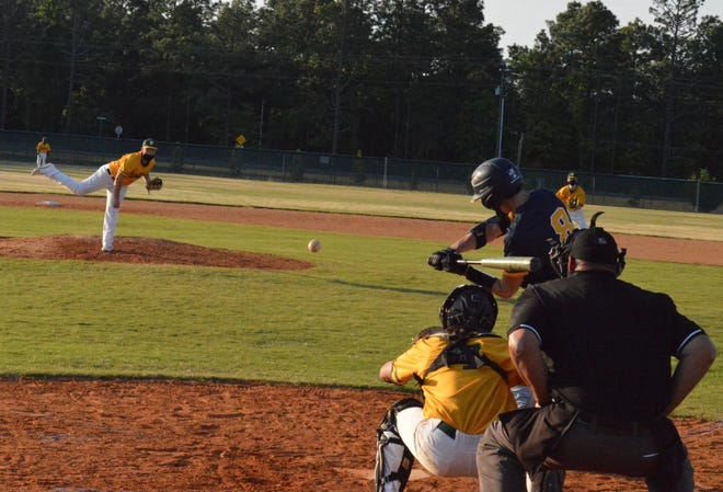 Junior outfielder Israel Ortiz (8) took this pitch over the center-field fence at Pine Forest for a grand slam in Cape Fear's 11-1 season-opening win.
