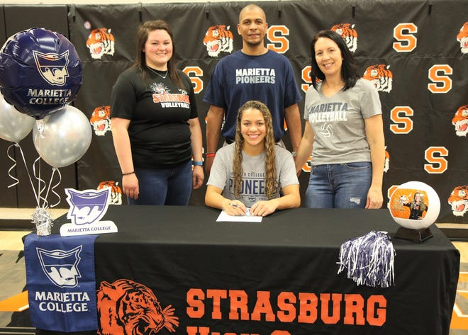 Strasburg senior Kylee Coles has signed a national letter of intent to continue her volleyball and academic career at Marietta College.  A volleyball, cheer, and basketball standout at Strasburg, Coles plans to Major in English.  Kylee is pictured with Strasburg Volleyball Coach Kaylyn Archer, mother, Nicole and father, Bryan.