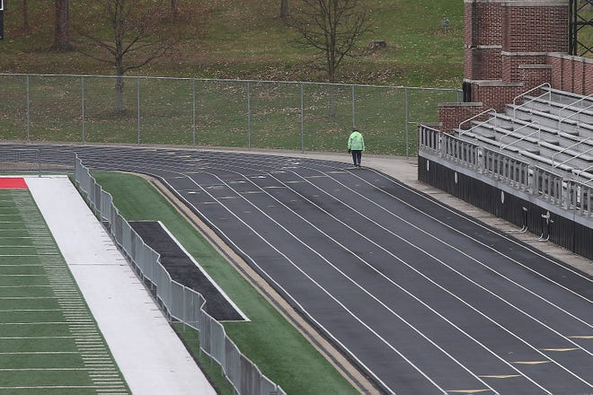 Community members use the track at Woody Hayes Quaker Stadium for morning walks.