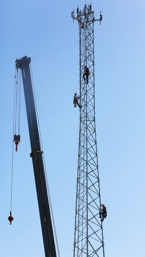 Workers climb new 140-foot tower on TUHS campus