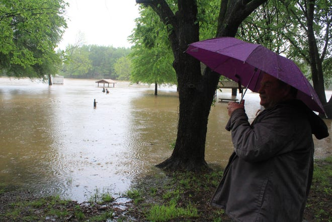 Steven Farquhar, 57, watches as towers wade into a flooded area in Clear Creek Park Campground Thursday, April 29, 2021, in the Alma area.