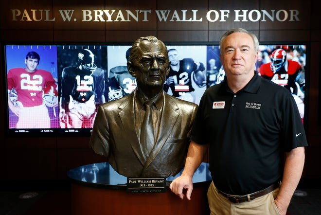 """Ken Gaddy stands with the statue of Paul """"Bear"""" Bryant in the Bryant Museum Thursday, April 22, 2021, where Gaddy is the director. He is retiring in May. [Staff Photo/Gary Cosby Jr.]"""