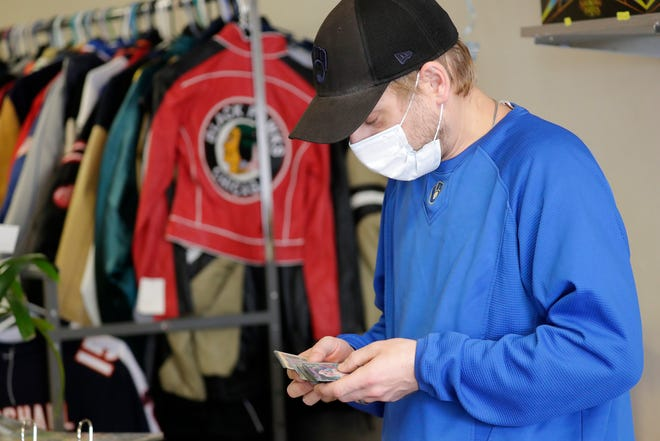 Collecting Haven co-owner Jake Novak sorts through collectible cards available for sale at his shop Wednesday, April 28, 2021, in downtown Kaukauna, Wis. Novak owns the shop with his wife Megan Novak.Dan Powers/USA TODAY NETWORK-Wisconsin