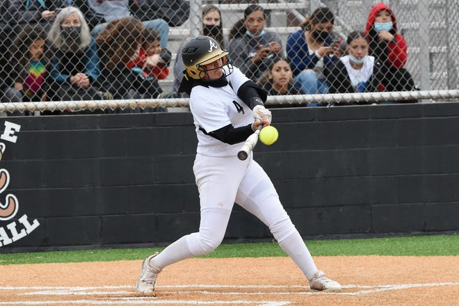 Abilene High's Bre Barajas (4) delivers a two-run home run against El Paso Montwood on Thursday during Game 1 of the Region I-6A bi-district playoff series on April 29, 2021. Barajas also hit a grand slam as the Lady Eagles won 19-9 in five innings.