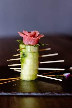 The Naruto roll at The Madness comes wrapped in cucumber.