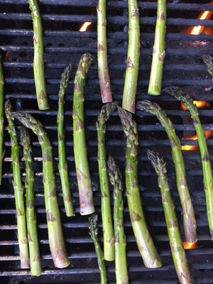 Grilled asparagus is a great beginning for a build-your-own recipe. You can experiment with sauces and toppings for this spring veg.