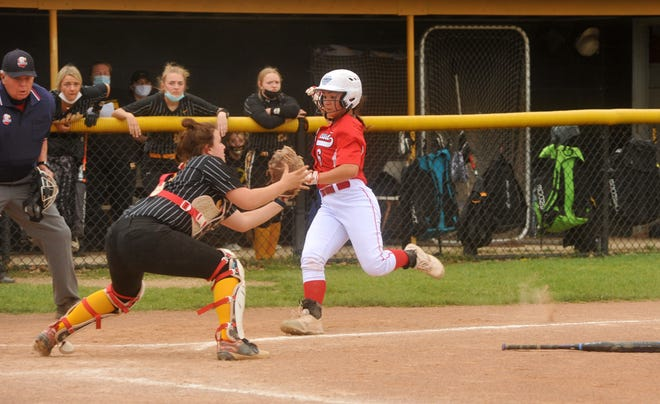 Bucyrus' Jade Torres sprints home to beat the tag from Colonel Crawford's Nettie Gallant.