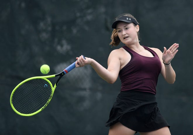 Calallen's Jenna Carr hits a forehand during her singles match against Devine's Brooke Runyan at the Regional IV-4A tennis tournament, Thursday, April 29, 2021. Carr won her match.
