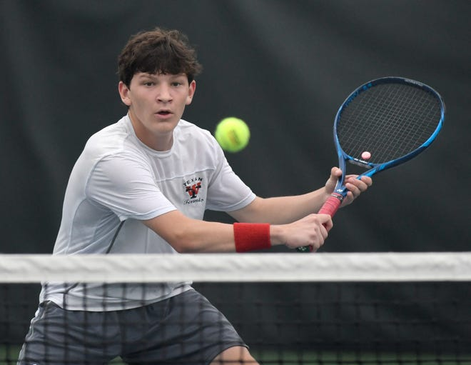 Wimberley's Drew Gonzales prepares to hit a backhand during his doubles match at the Class 4A Region IV tournament Thursday at the H-E-B Tennis Center in Corpus Christi. Gonzales and teammate Tate Murphy won the regional title to qualify for the state tournament.