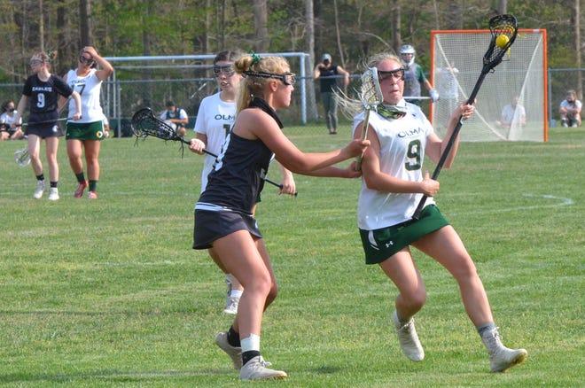 Egg Harbor midfielder Anna smith tries to slow down Our Lady of Mercy senior Adrianna Dodge