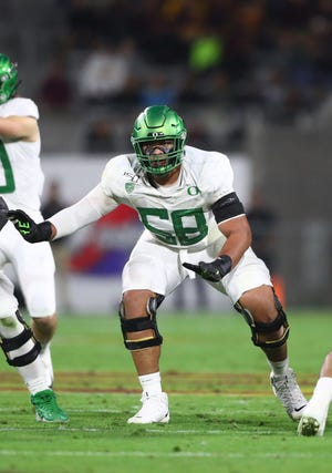 Detroit selected offensive lineman Penei Sewell with the seventh pick in the draft, despite uncertain long-term situation at quarterback.