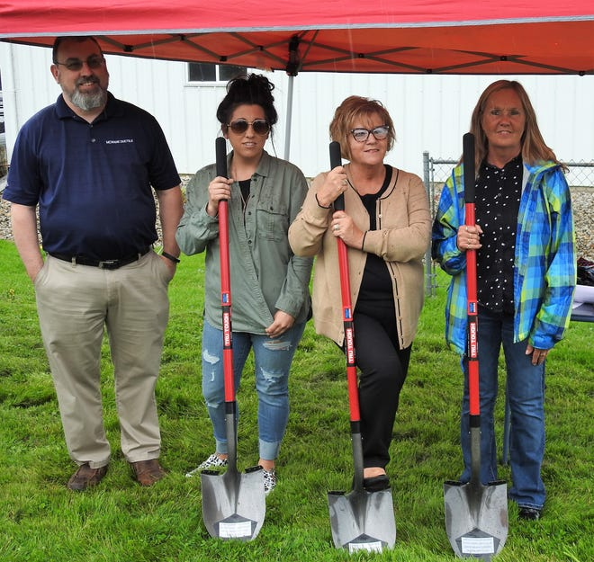 Clerk-Treasurer Cory Humphreys, Councilwoman Jennifer McFarland, Mayor Marge Donley and Councilwoman Annette Kimberly of the Village of Conesville at a groundbreaking ceremony for a new municipal building. It will feature a meeting room, garage and storage space for village records along with being handicapped accessible.