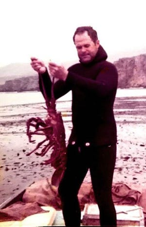 Donald Younce with a lobster he caught off the coast of California in the late 1960s.