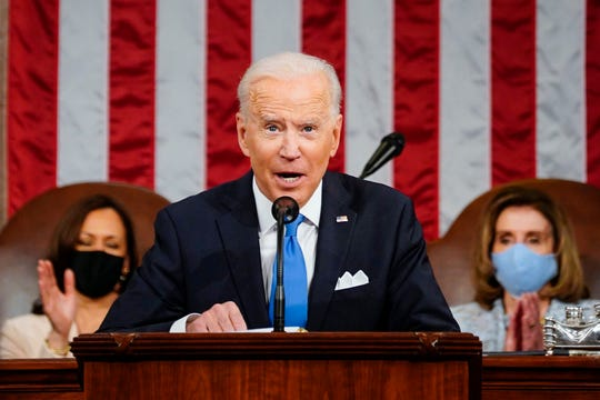 President Joe Biden addresses a joint session of Congress, Wednesday, April 28, 2021, in the House Chamber at the U.S. Capitol in Washington, as Vice President Kamala Harris, left, and House Speaker Nancy Pelosi of Calif., applaud.