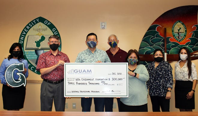 The Guam Board of Accountancy in December donated $300,000  to the School of Business and Public Administration at the University of Guam. The funds will go toward the Senator Herminia Dierking and John Phillips Visiting Accounting Professor and Lecturer Program, which provides access to specialized accounting professionals and classes not available in Guam. Pictured, from left, are: Annette T. Santos, dean of the School of Business and Public Administration; Thomas W. Krise, UOG president; John Onedera, president of the accountancy board; Dave Sanford, board executive director; Taling Taitano, board secretary; Katrina Perez, UOG Endowment Foundation executive director; and Daena Mansapit, the foundation's associate director of corporate and foundations.