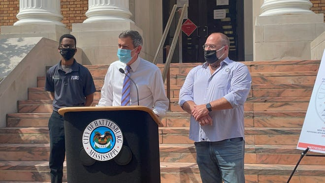 Hattiesburg Mayor Toby Barker announces a job fair for restaurants and the hospitality industry during a news conference on the steps of City Hall, Thursday, May 12, 2021, as Pyro's Pizza General Manager Edward Hargrove, left, and New South Restaurant Group owner Robert St. John listen.