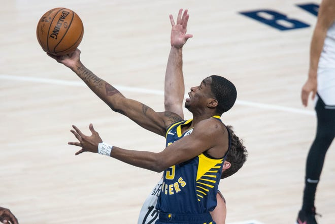 Apr 29, 2021; Indianapolis, Indiana, USA; Indiana Pacers guard Edmond Sumner (5) shoots the ball in the first quarter against the Brooklyn Nets at Bankers Life Fieldhouse.
