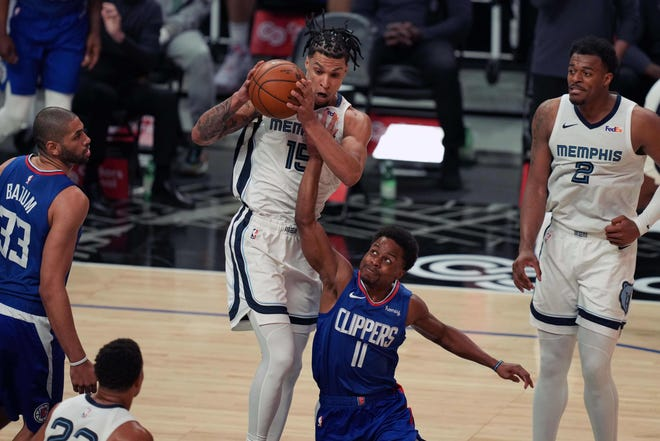 Apr 21, 2021; Los Angeles, California, USA; Memphis Grizzlies forward Brandon Clarke (15) and LA Clippers guard Yogi Ferrell (11) battle for the ball   in the second half at Staples Center. Mandatory Credit: Kirby Lee-USA TODAY Sports