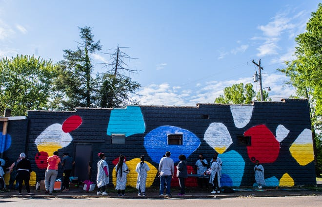 Keep My Hood Good students attend a workshop for the new mural being installed on the side of an abandoned building in east Jackson, Tenn on Friday, April 23, 2021. Artists, Wendy Kim and Ashley Akerson, designed and painted the mural.