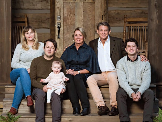 Jenny and Randy Boyd (center) pose with their sons, Harrison (right) and Thomas (left, holding child) and his wife, Lindsey.