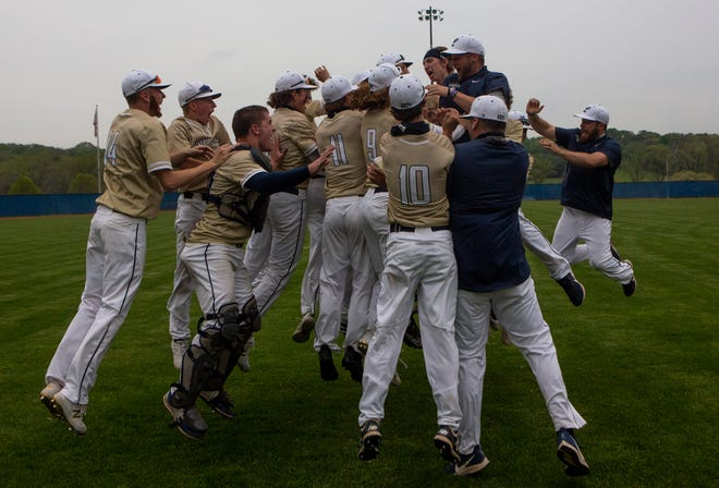The entire Lancaster High School baseball team celebrates in the outfield with their coaches after their win against Pickerington Central at Beavers Field in Lancaster, Ohio on April 28, 2021.