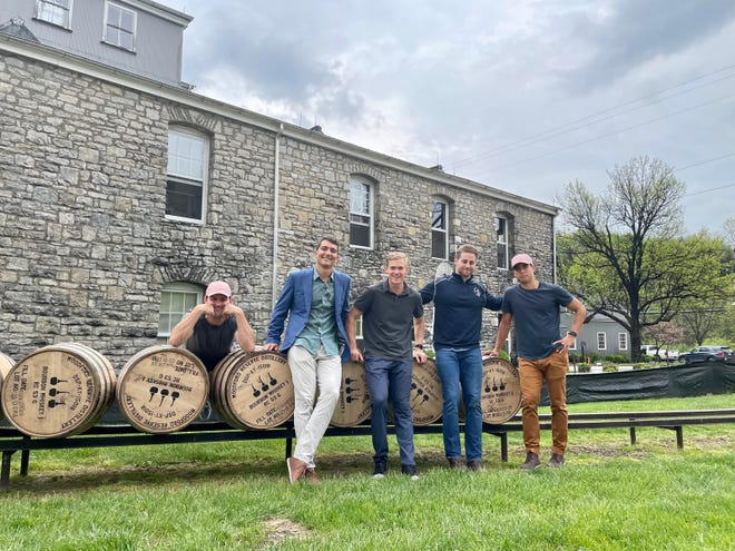 Eric Armagost, Dan Giovaccini, Reiley Higgins, Patrick O'Neill and Alex Quoyeser, owners of Derby hopeful Hot Rod Charlie, visit Woodford Reserve Distillery.