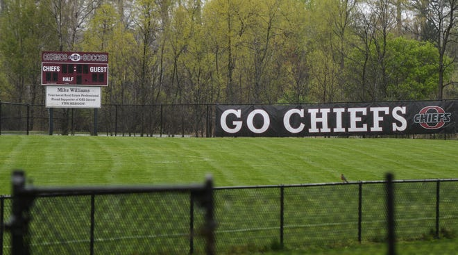The scoreboard and signage at Okemos High School's soccer field, seen April 29, 2021.