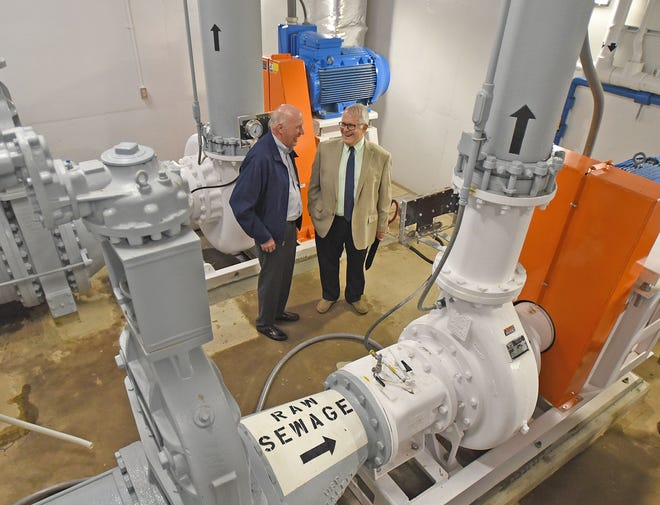 Jeff Gorman, of Gorman-Rupp, and Mansfield Mayor Tim Theaker share a laugh Thursday morning as the two get an up-close look at the new pumps at the city's largest municipal collection system lift station.