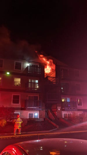 Firefighters battle a blaze that broke out in an exterior stairwell at the District apartment building at 1200 W. Bethel Ave. late Monday, April 26.