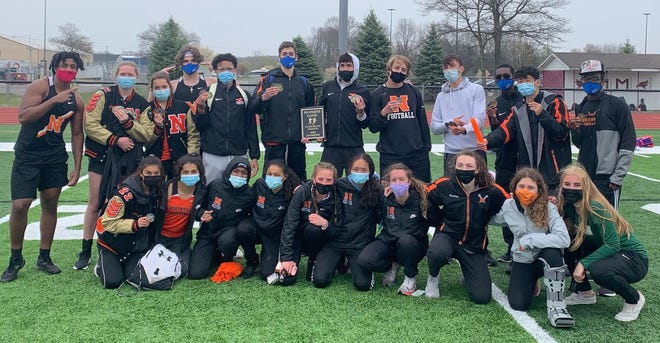 The Northville track and field team celebrates its Balawajder Classic Co-ed Relays  win.