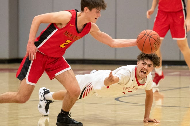 Palm Desert (wearing red) hosts Palm Springs High in a varsity basketball game in Palm Desert, Calif., on April 28, 2021. Palm Springs won.