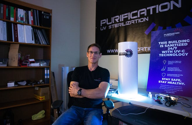 A portrait of Nicholas Knudsen with his Purification UV Sterlization unit, April 29, 2021, at Purification LLC, 1007 E. Warner Road, Tempe, Arizona.