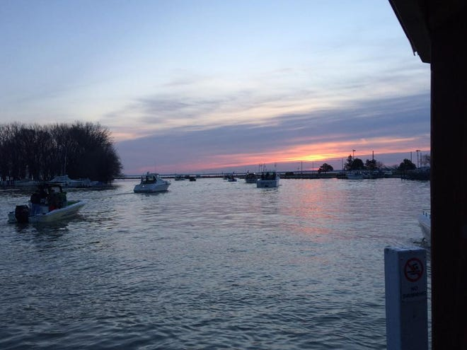 Boats head out on Lake Erie from the mouth of the Portage River near downtown Port Clinton to participate in the second annual Warriors Wangling Walleye tournament, which raises money for veterans charities.