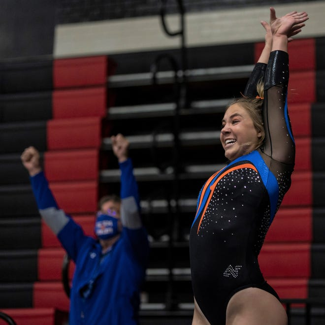 San Angelo Central High School's Madison Vogel and head coach Tony Walker react after she got a perfect 10 on vault during Day 1 of the Texas High School Gymnastics Championships at Euless on Wednesday, April 28, 2021.