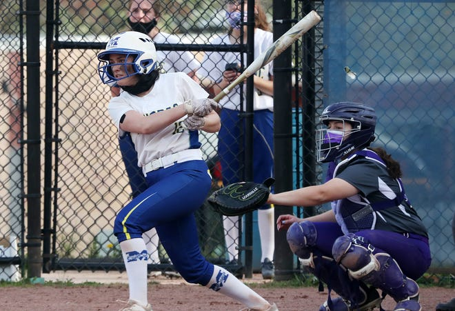 Mahopac's Michelle DellaMura (12, left) was voted lohud Softball Player of the Week.
