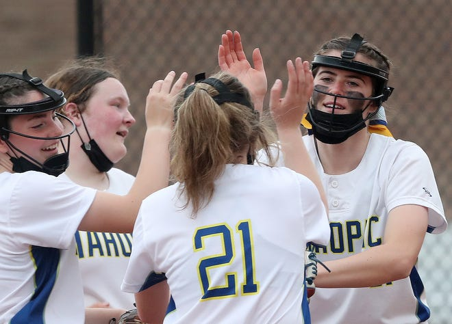 Mahopac's Shannon Becker celebrates with her teammates on her way to pitching a 2-hit shutout against Clarkstown North during softball action in Mahopac April 28, 2021. Mahopac won the game 11-0..