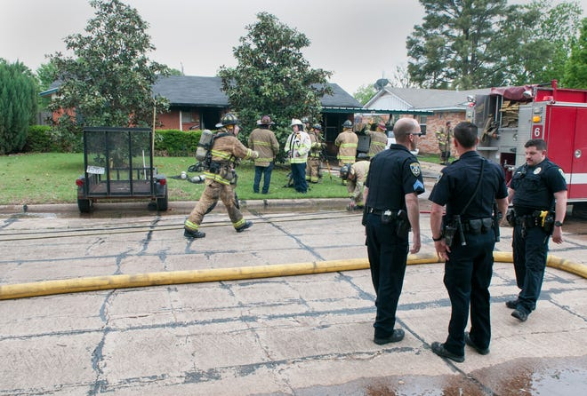 Wichita Falls firefighters and police officers responded to a house fire Thursday afternoon at a home on Karla Street.