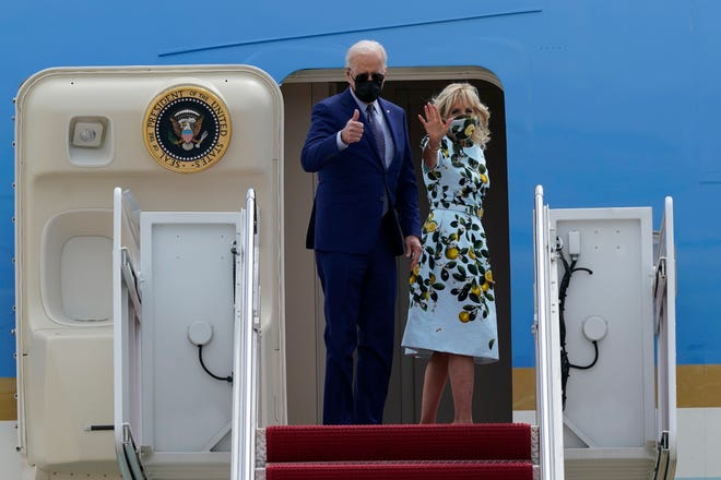 President Joe Biden and first lady Jill Biden waves from the top of the steps of Air Force One at Andrews Air Force Base, Md., Thursday, April 29, 2021.