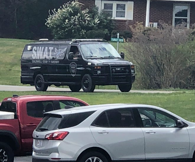A tactical van from Caldwell County, North Carolina, sits on stand-by at a staging area in Boone, North Carolina on Wednesday. Law enforcement agencies responded to a standoff in Boone in which two Watauga County Sheriff's deputies were shot and wounded.