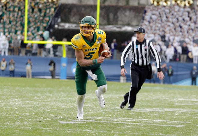 North Dakota State Bison quarterback Trey Lance (5) runs the ball in the first quarter against the James Madison Dukes at Toyota Stadium.