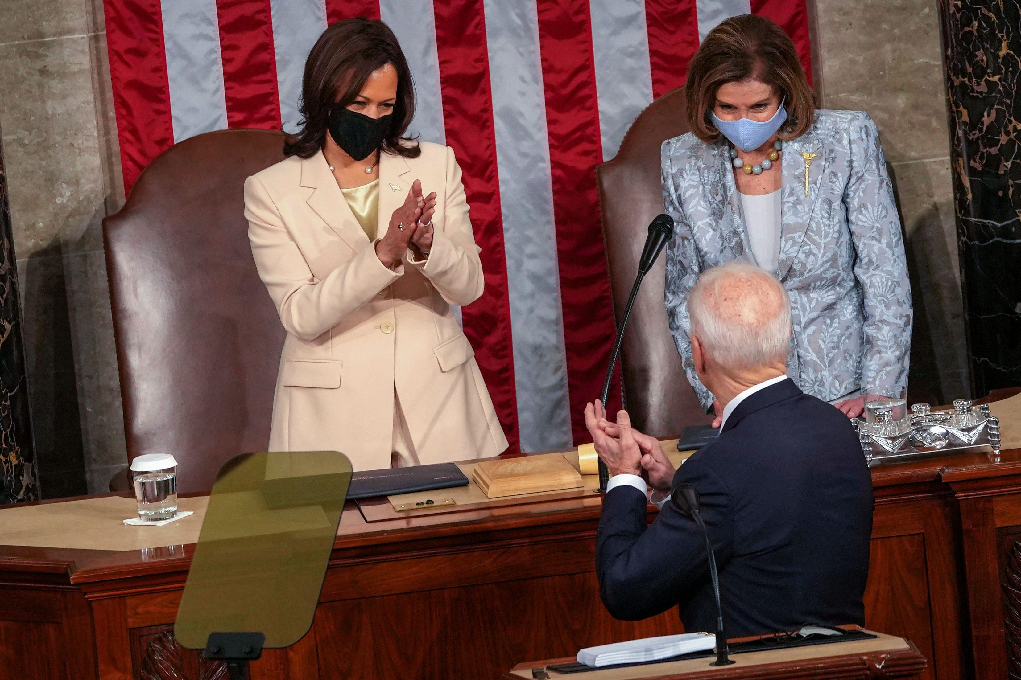 Vice President Kamala Harris and House Speaker Nancy Pelosi welcome President Joe Biden before he addresses a joint session of Congress.