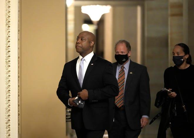 Sen. Tim Scott (R-SC) walks through the U.S. Capitol before he delivers the Republican response to President Biden's address to Congress April 28, 2021 in Washington, DC.