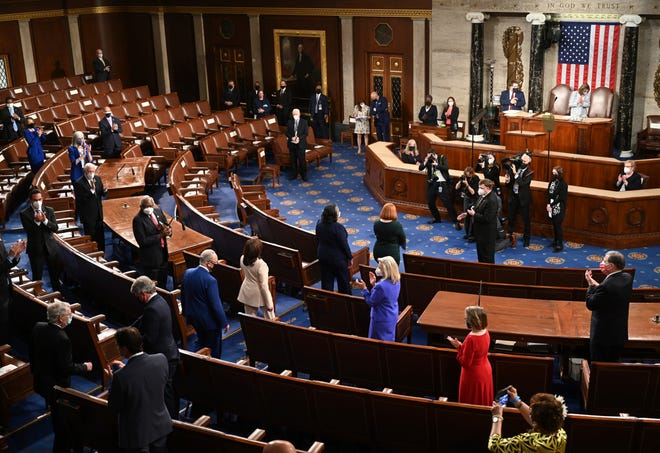 Members of Congress applaud as Vice President Kamala Harris, center, arrives before President Joe Biden addresses a joint session of Congress, Wednesday, April 28, 2021, in the House Chamber at the U.S. Capitol in Washington.